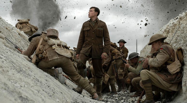 """his image released by Universal Pictures shows George MacKay, center, in a scene from """"1917,"""" directed by Sam Mendes."""