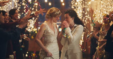 The Hallmark Channel says it will reinstate same-sex marriage commercials that it had pulled from the network.