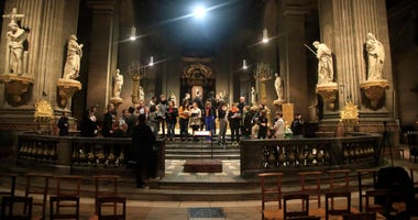 Members of the Notre Dame cathedral choir rehearse at the Saint Sulpice church in Paris.
