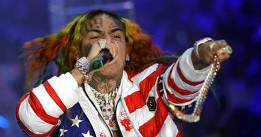 In this Sept. 21, 2018, file photo rapper Daniel Hernandez, known as Tekashi 6ix9ine, performs during the Philipp Plein women's 2019 Spring-Summer collection, unveiled during the Fashion Week in Milan, Italy.