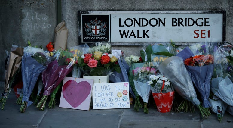 Tributes are placed by the southern end of London Bridge on Dec. 2, three days after a man stabbed two people to death and injured three others before being shot dead by police, in London.
