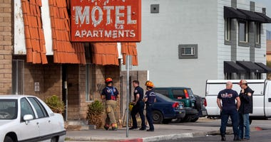 Las Vegas firefighters work the scene of a fire at a three-story apartment complex early Saturday in Las Vegas.