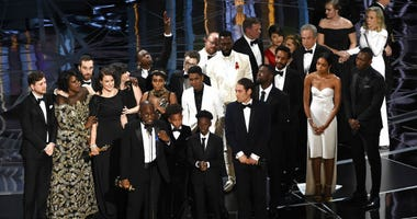 "FILE - This Feb. 26, 2017 file photo shows Barry Jenkins and the cast and crew of ""Moonlight"" accepting the award for best picture at the Oscars in Los Angeles."