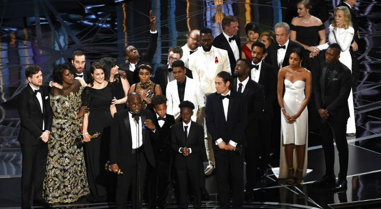 """FILE - This Feb. 26, 2017 file photo shows Barry Jenkins and the cast and crew of """"Moonlight"""" accepting the award for best picture at the Oscars in Los Angeles."""