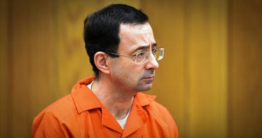 FILE - In this Feb. 5, 2018 file photo, Larry Nassar, former sports doctor who admitted molesting some of the nation's top gymnasts, appears in Eaton County Court in Charlotte, Mich.