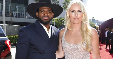FILE - In this July 10, 2019 file photo, P.K. Subban, left, of the New Jersey Devils, and Lindsey Vonn arrive at the ESPY Awards at Microsoft Theater in Los Angeles.