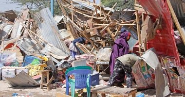 Somalis salvage goods after shops were destroyed in a car bomb in Mogadishu, Somalia, Saturday.