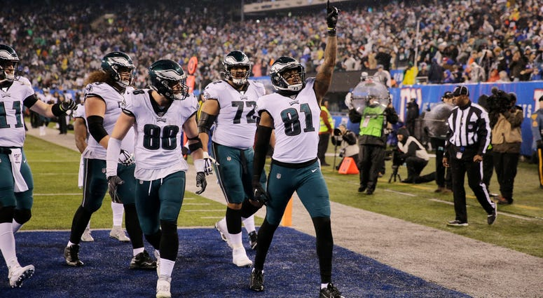 Philadelphia Eagles tight end Josh Perkins (81) celebrates scoring a touchdown in the first half of an NFL football game against the New York Giants, Sunday, Dec. 29, 2019, in East Rutherford, N.J.