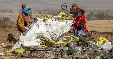 Rescuers work at the scene of an Ethiopian Airlines plane crash south of Addis Ababa, Ethiopia.