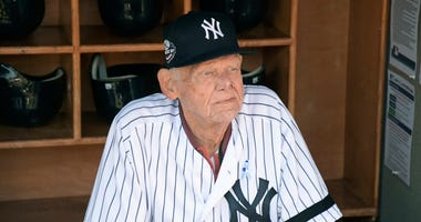 New York Yankees' Don Larsen sits in the dugout before the Yankees' Old-Timers' Day baseball game at Yankee Stadium in New York in 2018.