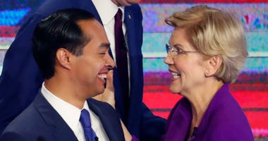 Democratic presidential candidates Sen. Elizabeth Warren, D-Mass., former Housing and Urban Development Secretary Julian Castro and New York City Mayor Bill de Blasio, center, share a moment at the end of a Democratic primary debate hosted by NBC News at