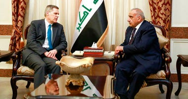 A photo released by the Iraqi Prime Minister Media Office, shows Iraqi acting Prime Minister Adil Abdul-Mahdi, right, meeting with U.S. Ambassador to Iraq Matthew Tueller at the prime minister's office, in Baghdad, Iraq, Monday, Jan. 6, 2020.