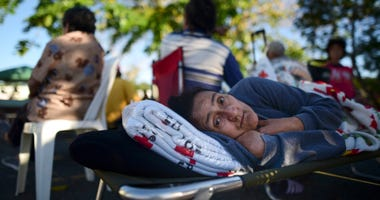 Maribel Rivera Silva, 58, rests outside a shelter, afraid of aftershocks, after an earthquake in Guanica, Puerto Rico, Tuesday, Jan. 7, 2020.