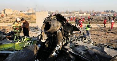 Debris at the scene where a Ukrainian plane crashed in Shahedshahr southwest of the capital Tehran, Iran.