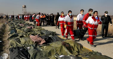 Rescue workers carry the body of a victim of a Ukrainian plane crash in Shahedshahr, southwest of Tehran, Iran.rescue workers carry the body of a victim of a Ukrainian plane crash in Shahedshahr, southwest of the capital Tehran, Iran, on Jan. 8.