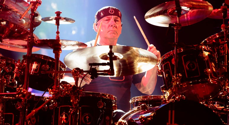Neil Peart of the band Rush performing in concert during their R40 Live: 40th Anniversary Tour in Philadelphia.