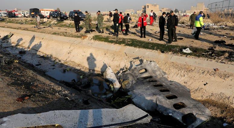Debris at the scene where a Ukrainian plane crashed in Shahedshahr southwest of the capital Tehran, Iran.