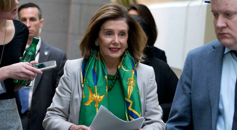 Speaker of the House Nancy Pelosi, D-Calif., arrives to meet with the Democratic Caucus at the Capitol in Washington, Tuesday, Jan. 14, 2020.