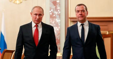 Russian President Vladimir Putin, left, and Russian Prime Minister Dmitry Medvedev walk prior to a cabinet meeting in Moscow, Russia, Wednesday, Jan. 15, 2020.