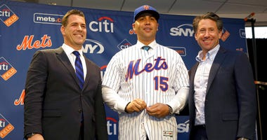 In this Nov. 4, 2019, file photo, new New York Mets manager, Carlos Beltran, center, poses for a picture with general manager Brodie Van Wagenen, left, and Mets COO Jeff Wilpon during a baseball news conference at Citi Field in New York.