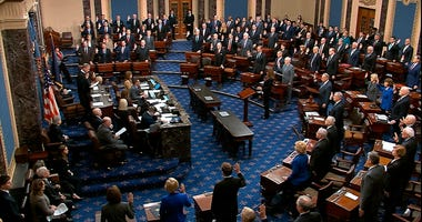 In this image from video, presiding officer Supreme Court Chief Justice John Roberts swears in members of the Senate for the impeachment trial against President Donald Trump at the U.S. Capitol in Washington, Thursday, Jan. 16, 2020.
