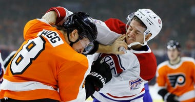 Montreal Canadiens' Jesperi Kotkaniemi, right, and Philadelphia Flyers' Robert Hagg fight during the third period of an NHL hockey game, Thursday, Jan. 16, 2020, in Philadelphia.