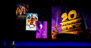 FILE - In this April 3, 2019, file photo, Alan Horn, chairman of The Walt Disney Studios, speaks underneath poster images for 20th Century Fox films during the Walt Disney Studios Motion Pictures presentation at CinemaCon 2019.