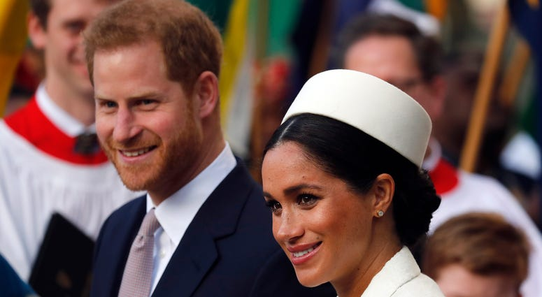 In this file photo, Britain's Prince Harry and Meghan, the Duchess of Sussex leave after the Commonwealth Service at Westminster Abbey in London.