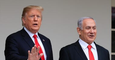 President Donald Trump welcomes visiting Israeli Prime Minister Benjamin Netanyahu to the White House in Washington on March 25, 2019.