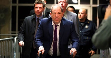 Harvey Weinstein, center, exits following his trial on charges of rape and sexual assault, Monday, Jan. 27, 2020, in New York.