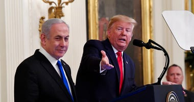 President Donald Trump, joined by Israeli Prime Minister Benjamin Netanyahu, speaks during an event in the East Room of the White House in Washington, Tuesday, Jan. 28, 2020.