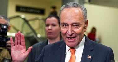 Senate Minority Leader Chuck Schumer, D-N.Y., gestures as he talks to media at the Capitol in Washington, Tuesday, Jan.28, 2020.