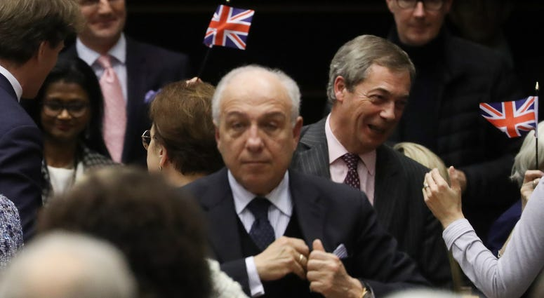 Brexit Party leader Nigel Farage, third right, reacts after the vote on the UK's withdrawal from the EU, the final legislative step in the Brexit proceedings, during the plenary session at the European Parliament in Brussels, Wednesday, Jan. 29, 2020.