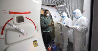 Quarantine workers in protective suits