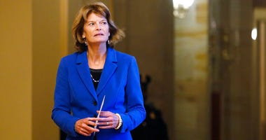 Sen. Lisa Murkowski, R-Alaska, returns to the Senate chamber after a meeting in the Majority Leaders office during a break in the impeachment trial of President Donald Trump at the U.S. Capitol Friday Jan 31, 2020, in Washington.