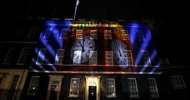 An image of the clock face of 'Big Ben' is projected onto the exterior of 10 Downing street, the residence of the British Prime Minister, in London as Britain left the European Union, Friday, Jan. 31, 2020.