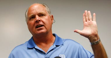 In this Jan. 1, 2010 file photo, conservative talk show host Rush Limbaugh speaks during a news conference at The Queen's Medical Center in Honolulu.