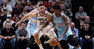 Miami Heat forward Jimmy Butler (22) drives to the basket as Philadelphia 76ers guard Ben Simmons (25) defends during the first half of an NBA basketball game, Monday, Feb. 3, 2020, in Miami.