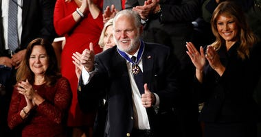 Rush Limbaugh reacts as first Lady Melania Trump prepares to present him with the the Presidential Medal of Freedom as President Donald Trump delivers his State of the Union address.