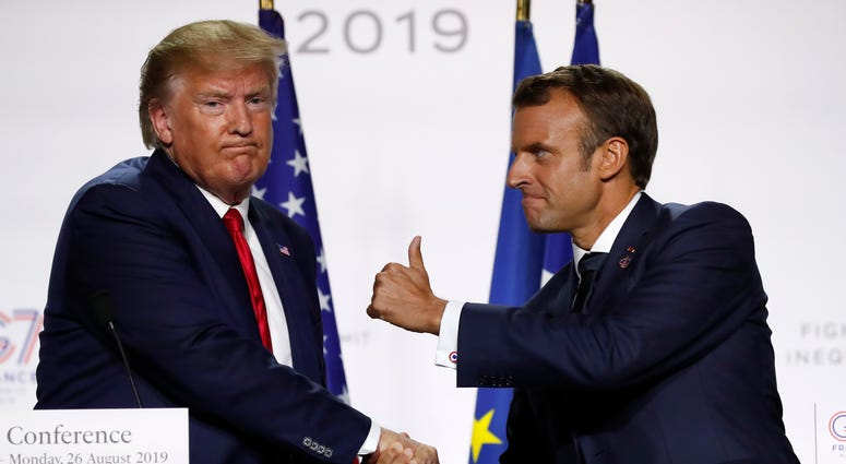 French President Emmanuel Macron and U.S President Donald Trump shake hands during the final press conference during the G7 summit in Biarritz, southwestern France, Aug. 26, 2019.