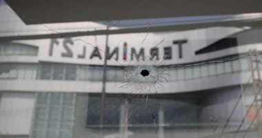 Bullet holes reflect the Terminal 21 Korat mall in Nakhon Ratchasima, Thailand, Sunday.