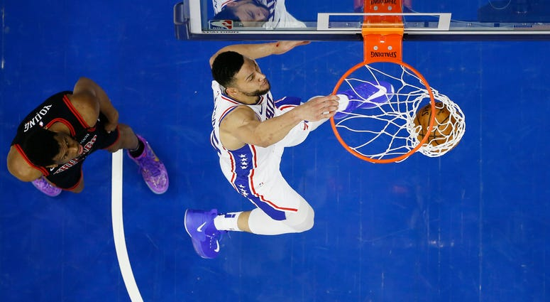 Philadelphia 76ers' Ben Simmons, right, dunks past Chicago Bulls' Thaddeus Young during the first half of an NBA basketball game, Sunday, Feb. 9, 2020, in Philadelphia.