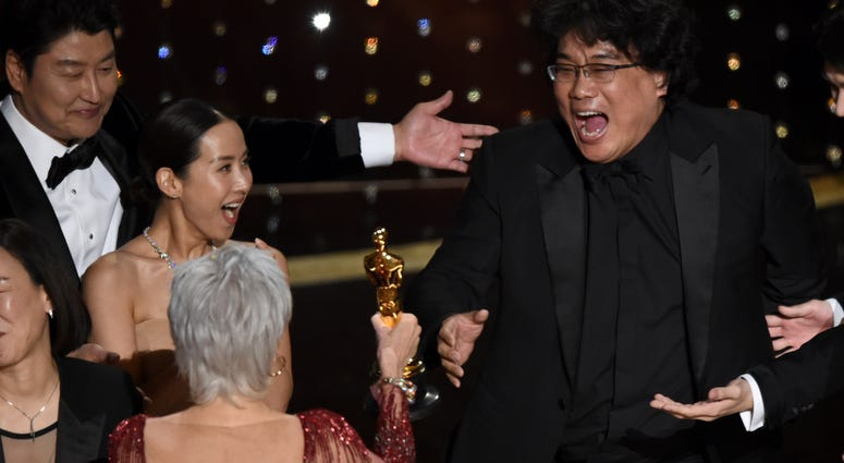 "Bong Joon Ho, right, reacts as he is presented with the award for best picture for ""Parasite"" from presenter Jane Fonda at the Oscars on Sunday, Feb. 9, 2020, at the Dolby Theatre in Los Angeles."