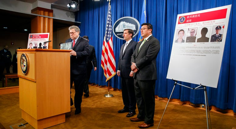 "Attorney General William Barr, left, arrives to speak, next to Assistant Attorney General John Demers and U.S. Attorney for the Northern District of Georgia Byung ""BJay"" Pak, right, during a news conference."