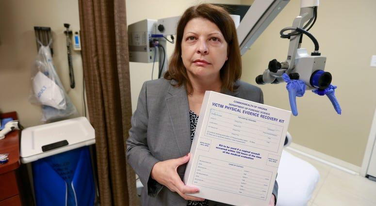 Director of forensic nursing program holds a rape evidence kit