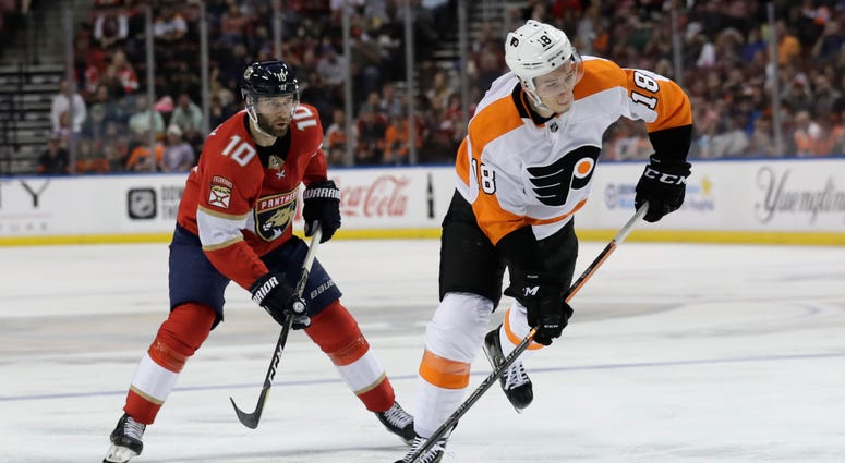 Philadelphia Flyers center Tyler Pitlick (18) prepares to shoot as Florida Panthers right wing Brett Connolly (10) defends during the second period of an NHL hockey game Thursday, Feb. 13, 2020, in Sunrise, Fla.