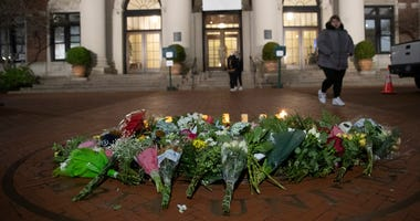 In this Dec. 12, 2019 file photo, a woman walks past a make-shift memorial for Tessa Majors inside the Barnard College campus in New York.