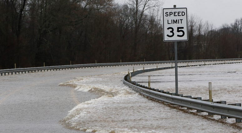 Strong currents from the swollen Pearl River flood over the Old Brandon Road Bridge in Jackson, Miss., Sunday, Feb. 16, 2020.