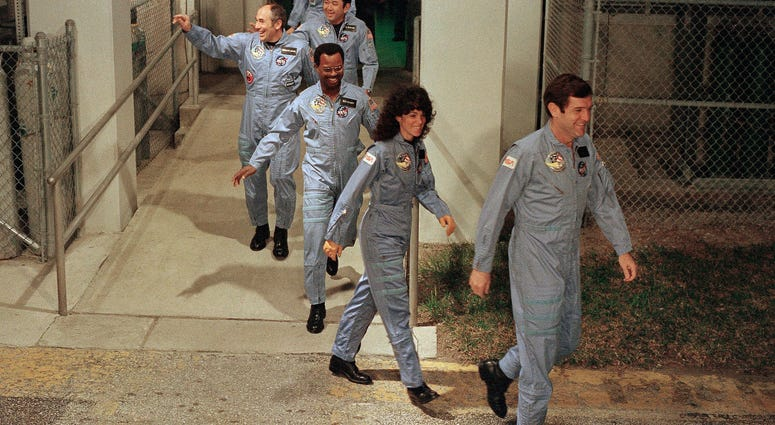 The crew for the Space Shuttle Challenger flight 51-L leaves their quarters for the launch pad at the Kennedy Space Center in Florida on Jan. 27, 1986.