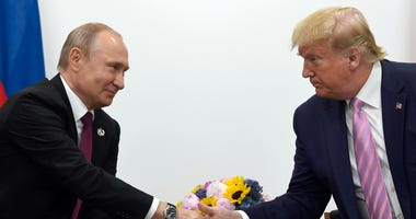 President Donald Trump, right, shakes hands with Russian President Vladimir Putin, left, during a bilateral meeting on the sidelines of the G-20 summit in Osaka, Japan, on June 28, 2019.